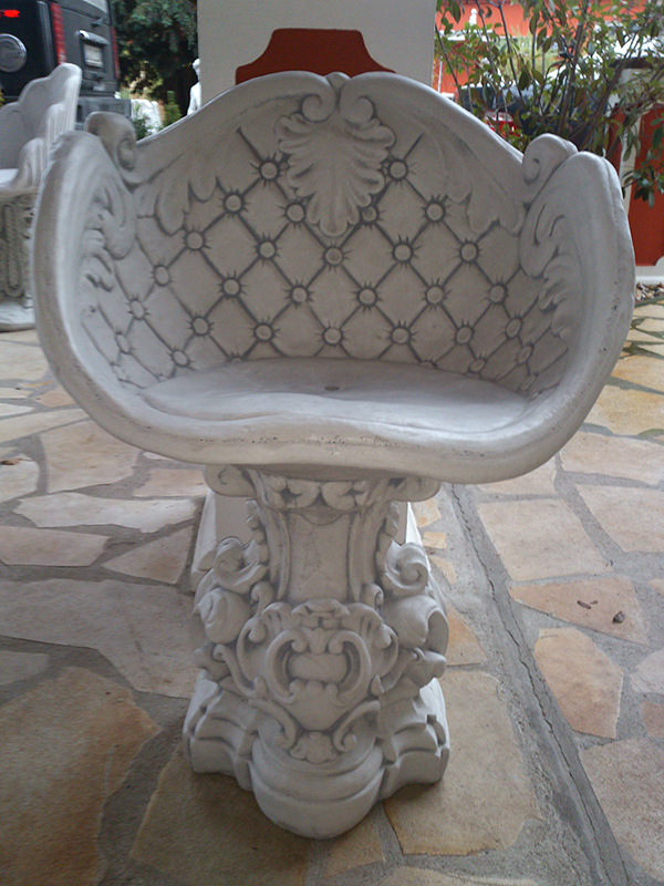 massive white concrete decorative garden armchair in baroque sty