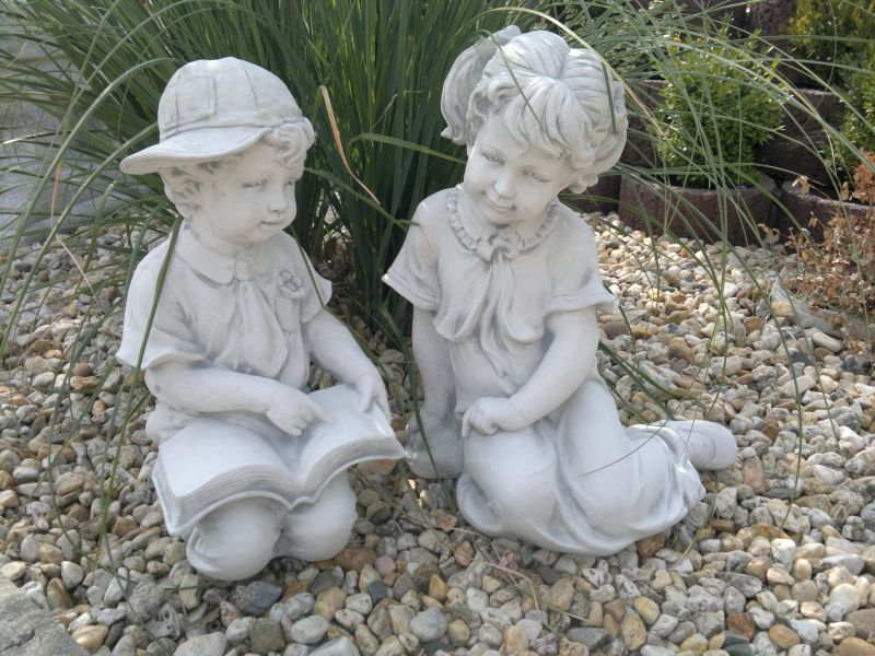 2 cute garden figures boy and girl