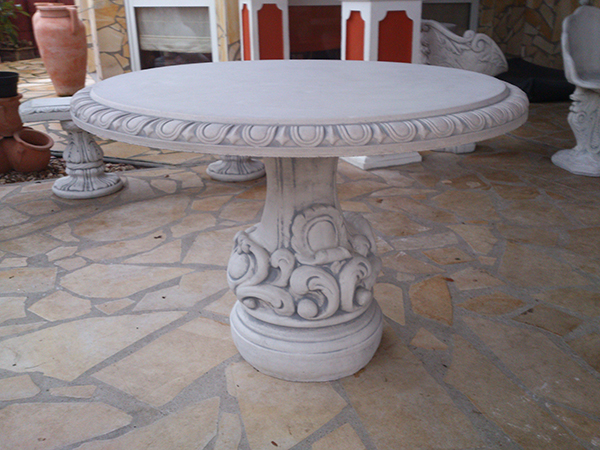 Massive decorative garden table with a round shape in the Baroqu